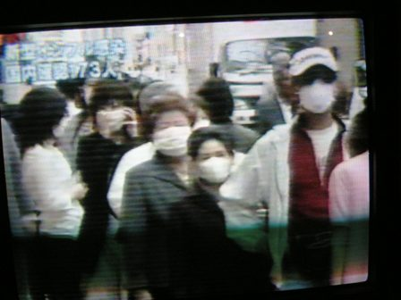 NHK news queuw for masks on the 23rd May 09 resized for web.jpg